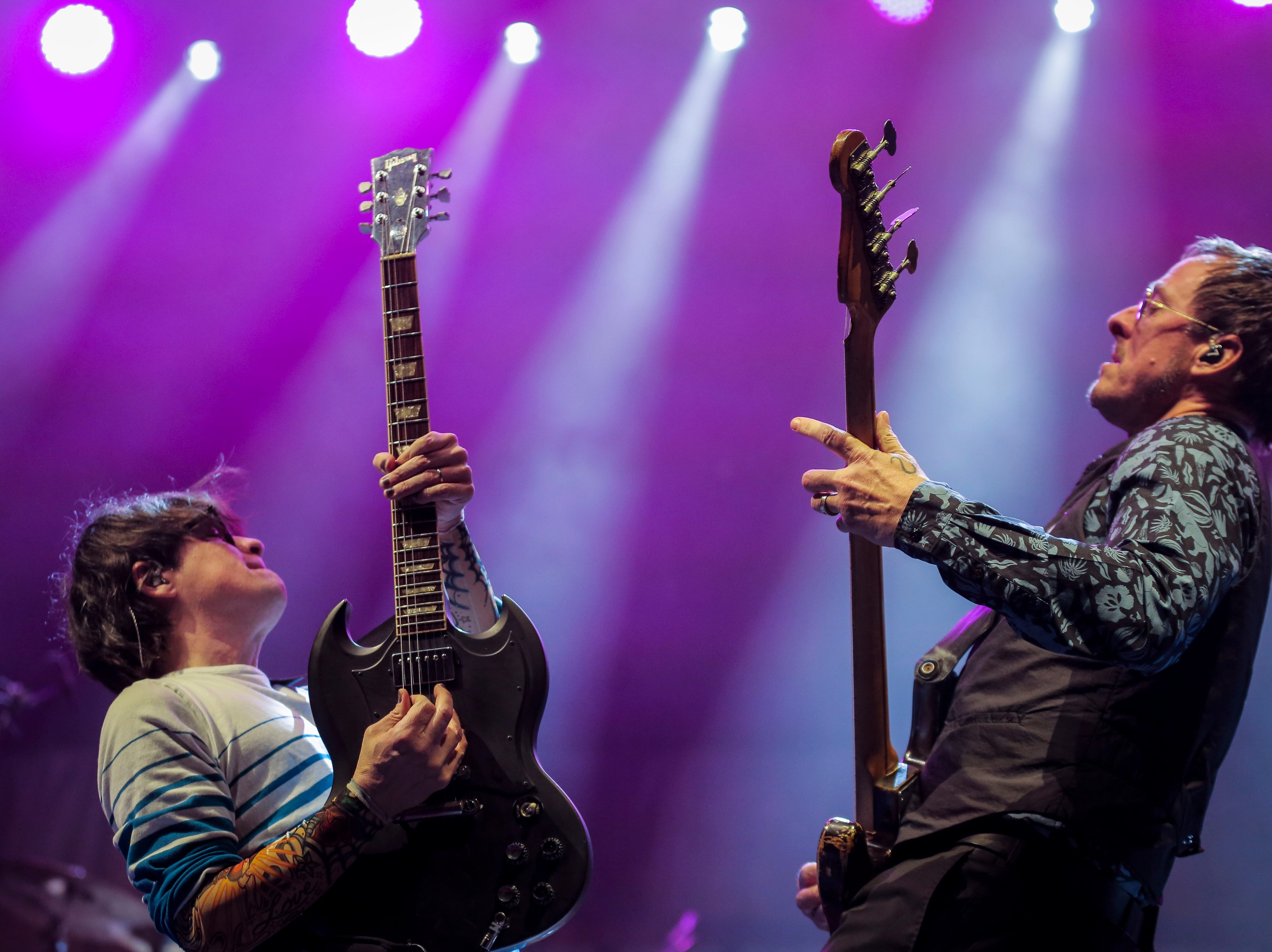 Rivers Cuomo, lead vocals and guitarist, left, and Scott Shriner, bassist, of Weezer play together during the first show of the Weezer x Pixies 2019 tour at the KFC Yum! Center in downtown Louisville, Ky. on Friday, March 8, 2019.