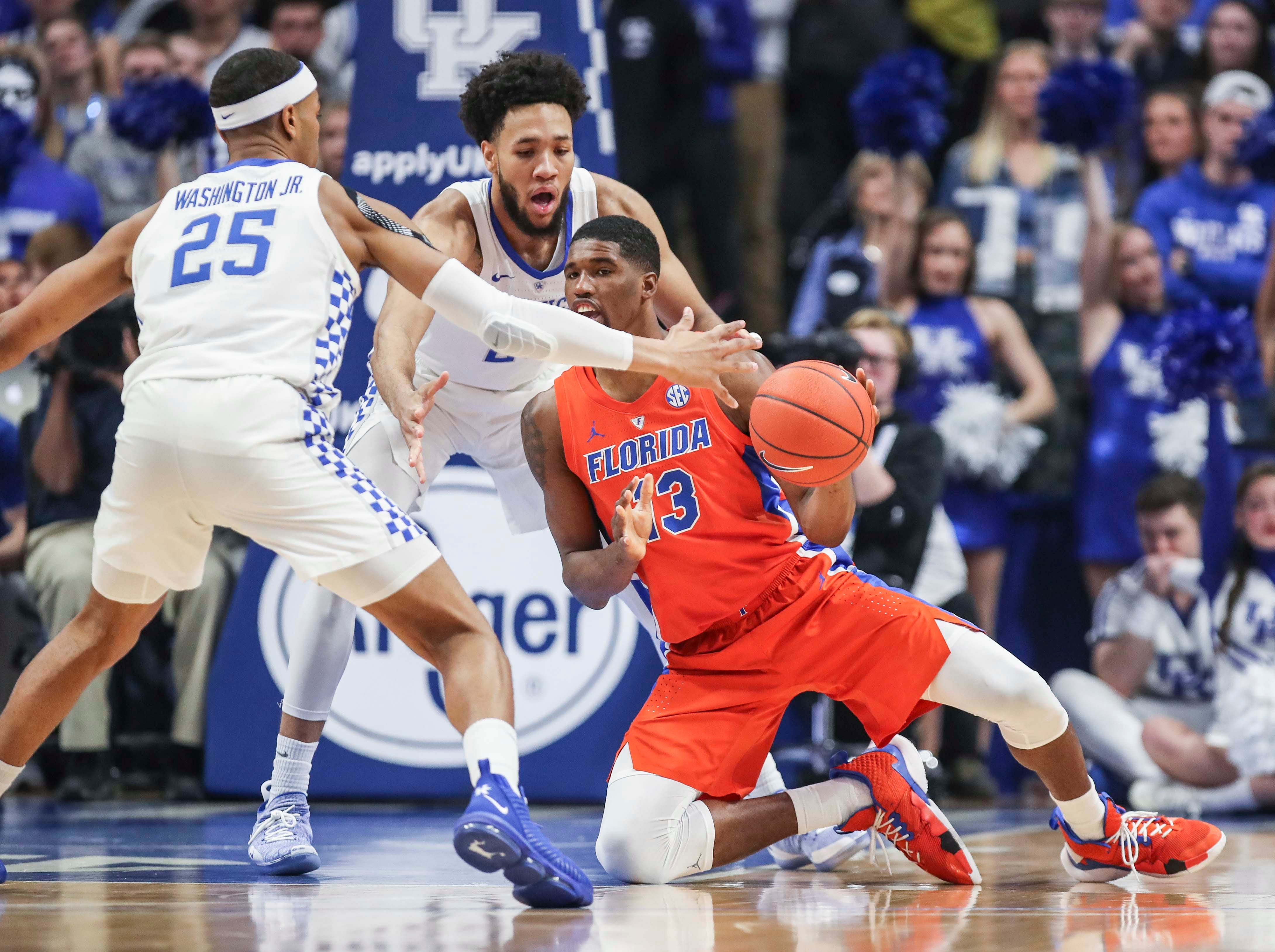 Kentucky's PJ Washington Jr., left and EJ Montgomery pressure Florida's Kevarrius Hayes in the first half against Florida.  March 9, 2019