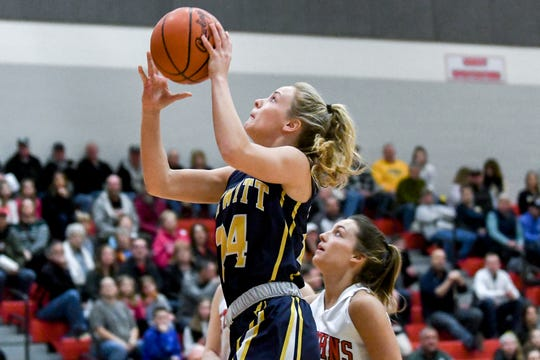 DeWitt's Annie McIntosh shoots a layup during the first quarter on Friday, March 8, 2019, in St. Johns.