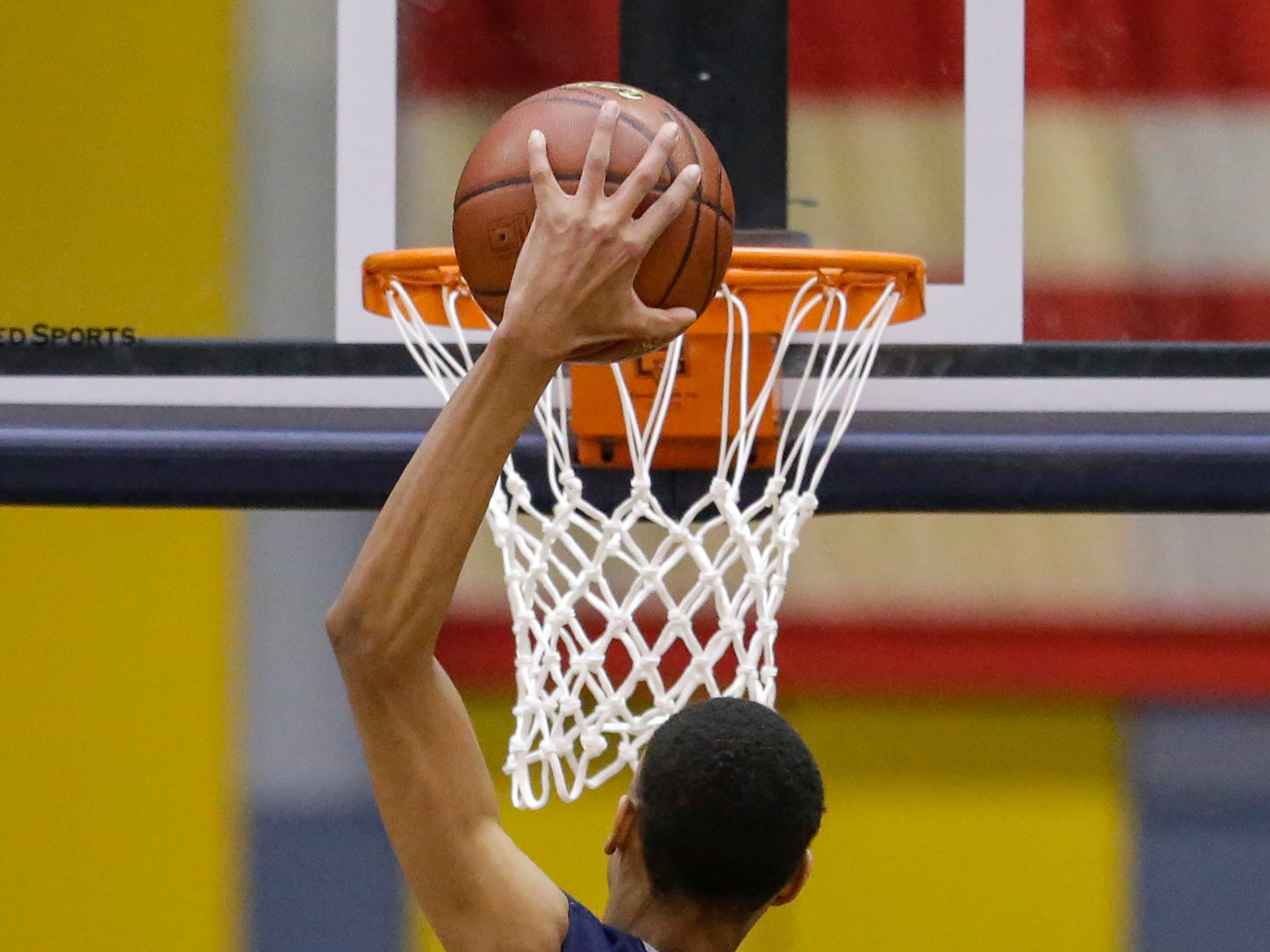 Milwaukee Academy of Science's Darius Hannah (35) dunks the ball against Roncalli during a WIAA Division 4 sectional championship at Sheboygan North High School Saturday, March 9, 2019, in Sheboygan, Wis. Joshua Clark/USA TODAY NETWORK-Wisconsin