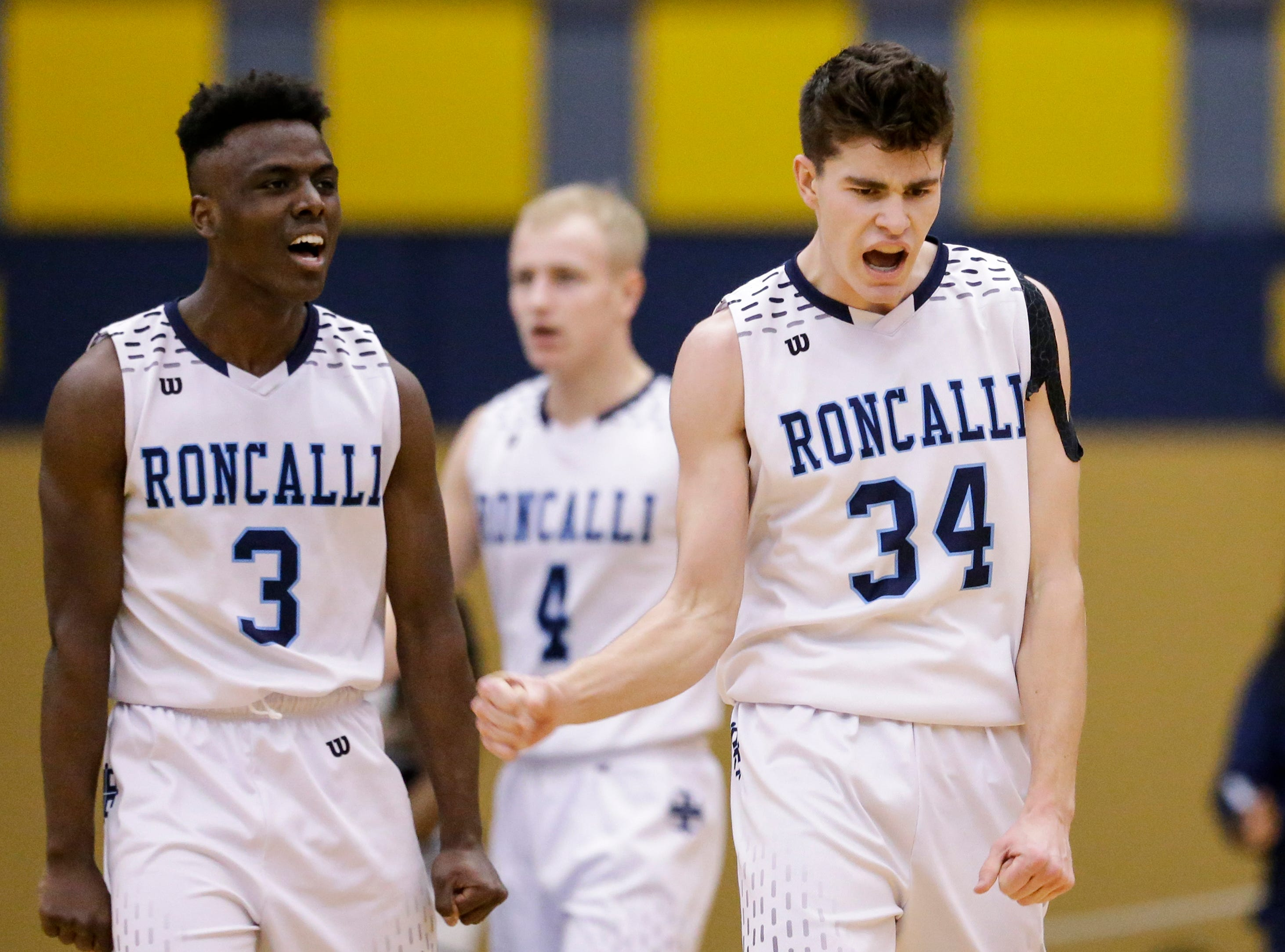 Roncalli's Chombi Lambert (3) and Ian Behringer (34) react after gaining possession over Milwaukee Academy of Science during a WIAA Division 4 sectional championship at Sheboygan North High School Saturday, March 9, 2019, in Sheboygan, Wis. Joshua Clark/USA TODAY NETWORK-Wisconsin
