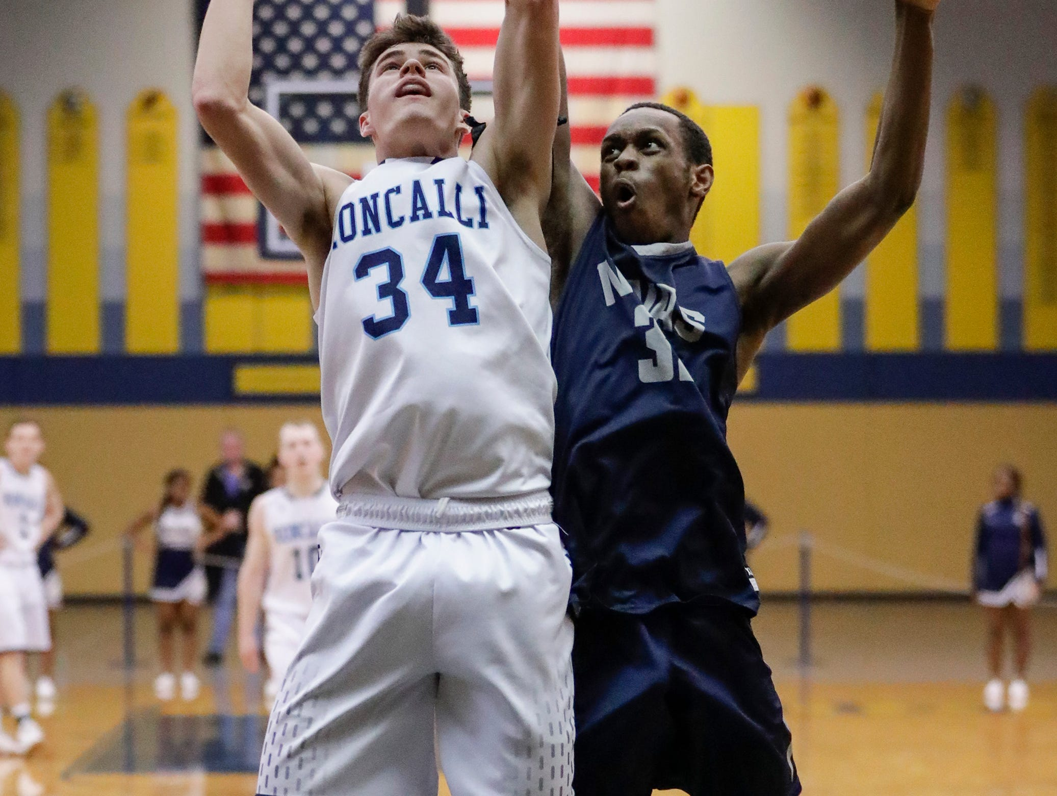 Roncalli's Ian Behringer (34) takes it to the basket against Milwaukee Academy of Science's Anthony Rose (32) during a WIAA Division 4 sectional championship at Sheboygan North High School Saturday, March 9, 2019, in Sheboygan, Wis. Joshua Clark/USA TODAY NETWORK-Wisconsin
