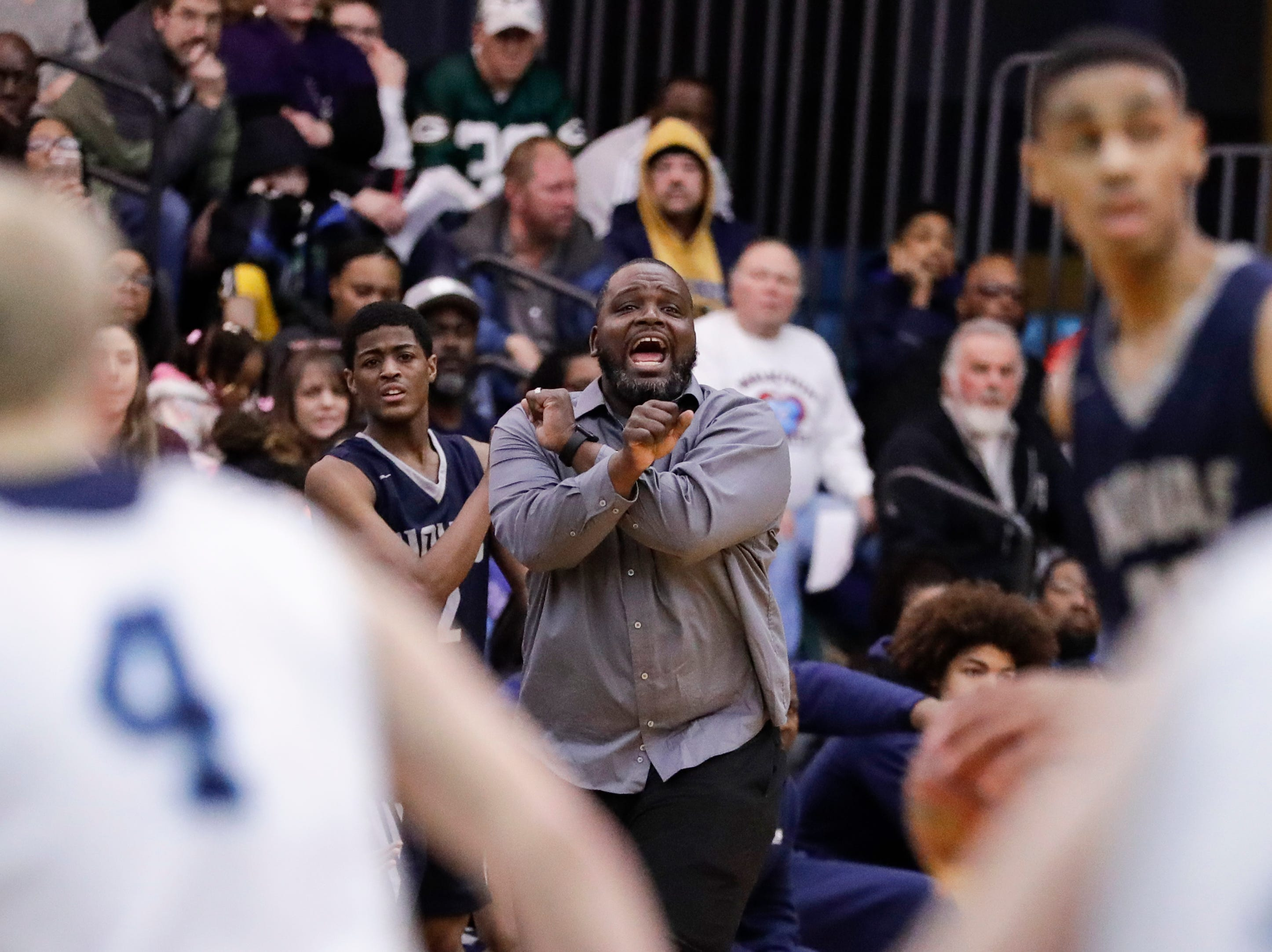 Milwaukee Academy of Science's head coach Agape Keys talks to his team during a WIAA Division 4 sectional championship game against Roncalli at Sheboygan North High School Saturday, March 9, 2019, in Sheboygan, Wis. Joshua Clark/USA TODAY NETWORK-Wisconsin