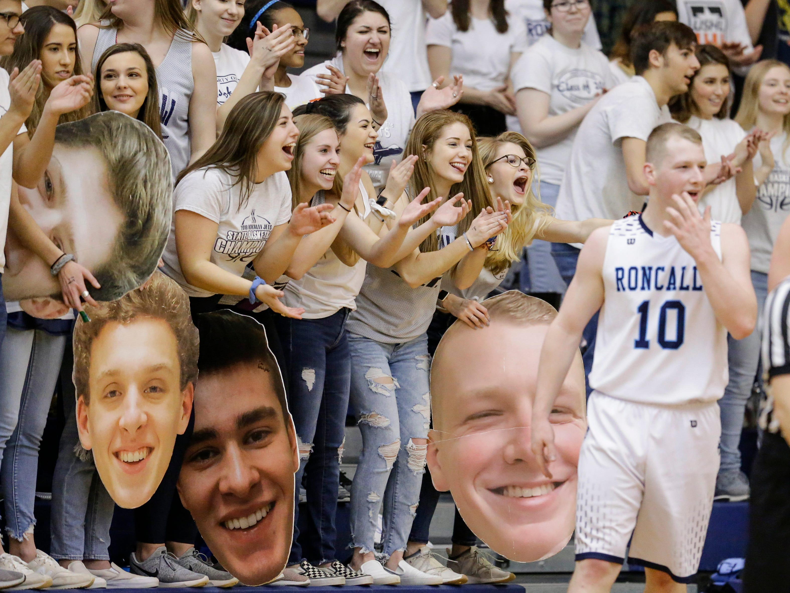 The Roncalli student sections cheers as the Jets widen their lead against Milwaukee Academy of Science during a WIAA Division 4 sectional championship at Sheboygan North High School Saturday, March 9, 2019, in Sheboygan, Wis. Joshua Clark/USA TODAY NETWORK-Wisconsin