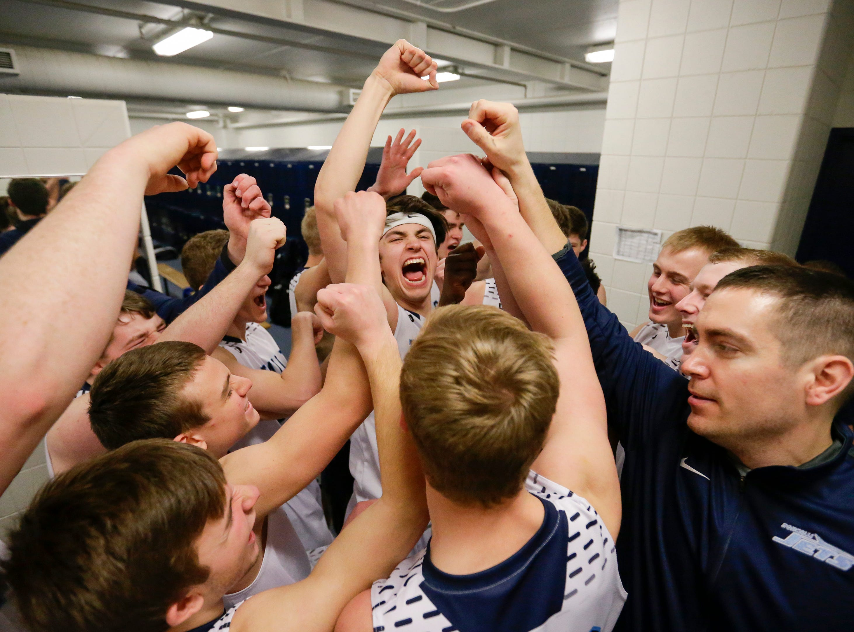 Roncalli cheers in the locker room after defeating Milwaukee Academy of Science in a WIAA Division 4 sectional championship at Sheboygan North High School Saturday, March 9, 2019, in Sheboygan, Wis. Joshua Clark/USA TODAY NETWORK-Wisconsin