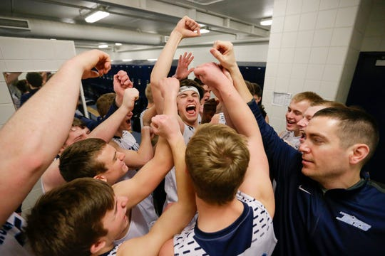 Roncalli cheers in the locker room after defeating Milwaukee Academy of Science in a WIAA Division 4 sectional championship Saturday at Sheboygan North High School.