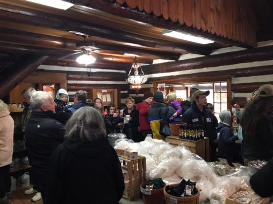 Maple cotton candy and other maple goodies, including syrup, are sold at the Malabar Farm Maple Syrup Festival on Saturday in Pugh Cabin.