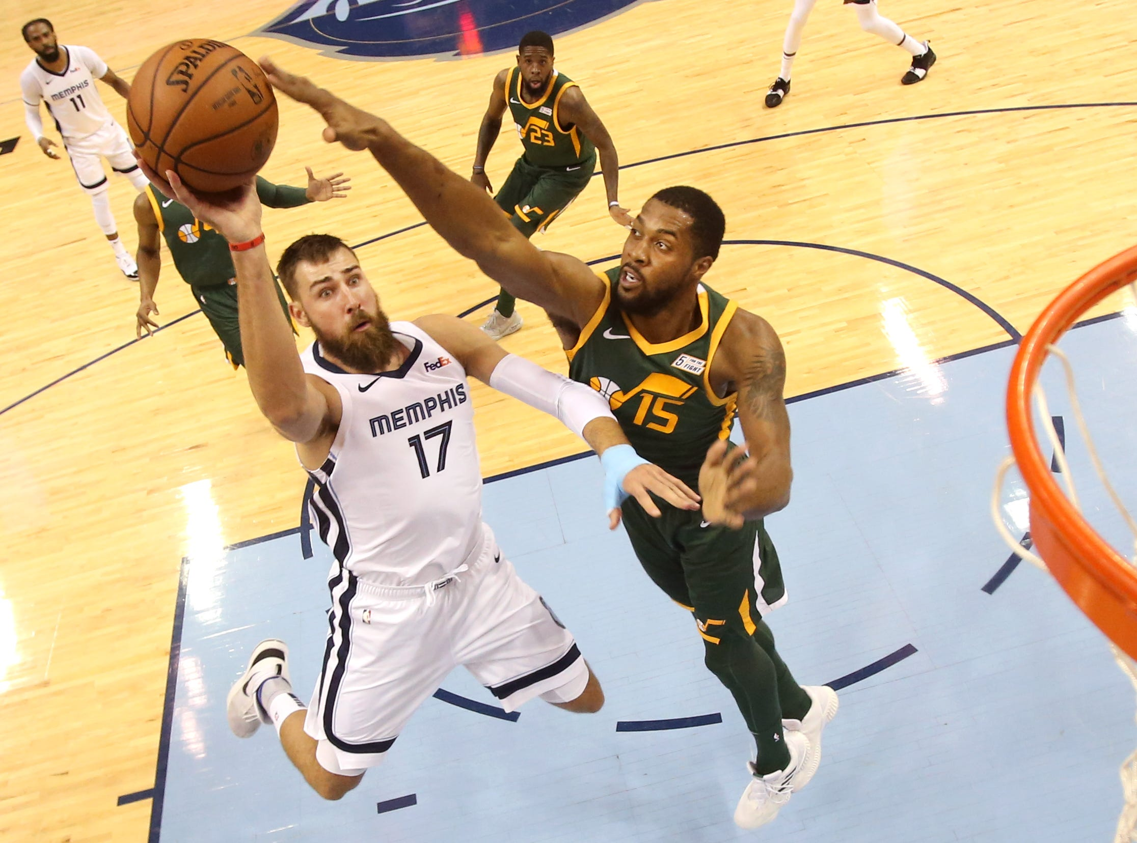 Memphis Grizzlies center Jonas Valanciunas shoots the ball over Utah Jazz forward Derrick Favors during their game at the FedExForum on Friday, March 8, 2019.