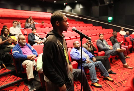 Tyjuan Criswell, a senior at Manassas High School, asks a question of the panel during the Maximizing Manhood Symposium on Saturday.