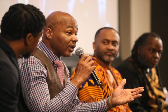 Darron Smith speaks in a panel discussion entitled Mastering our Cultural Identity during the Maximizing Manhood Symposium at the Halloran Centre for Performing Arts & Education on Saturday.