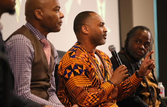Earle Fisher speaks during a discussion entitled Mastering our Cultural Identity during the Maximizing Manhood Symposium on Saturday.