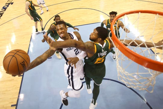 Memphis Grizzlies guard Delon Wright tries to lay the ball up past Utah Jazz forward Derrick Favors during their game at the FedExForum on Friday, March 8, 2019.