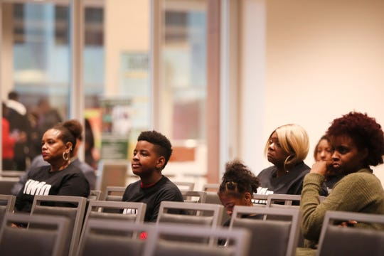 Guests listen in to a discussion at the Maximizing Manhood Symposium on Saturday.