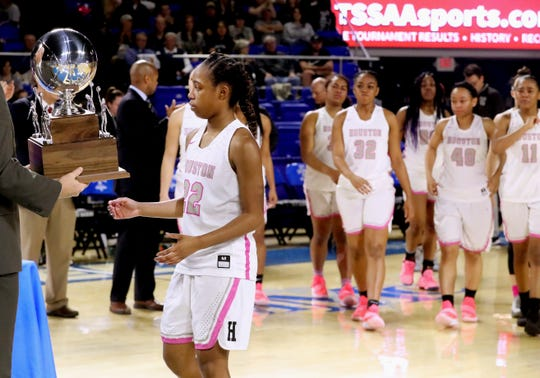 Houston's Nakiyah Westbrook (22) receives the State Runner-up trophy for Div. 1 Class AAA as the rest of the team comes up to receive the trophy also, on Saturday, March 9, 2019, after losing to Bradley Central in the Championship game at Murphy Center in Murfreesboro, Tenn.