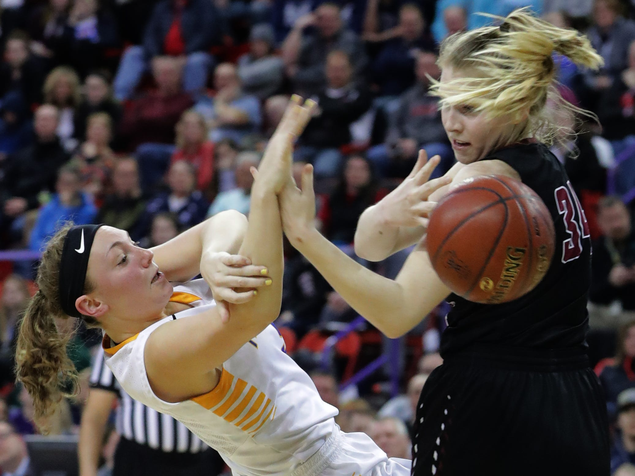 Mukwonago's Grace Beyer (5) loses the ball after colliding with Middleton's Hannah Flottmeyer (34) during the second half of their WIAA Division 1 state semifinal game March 8, 2019, at the Resch Center in Ashwaubenon. Middleton beat Mukwonago, 62-53.