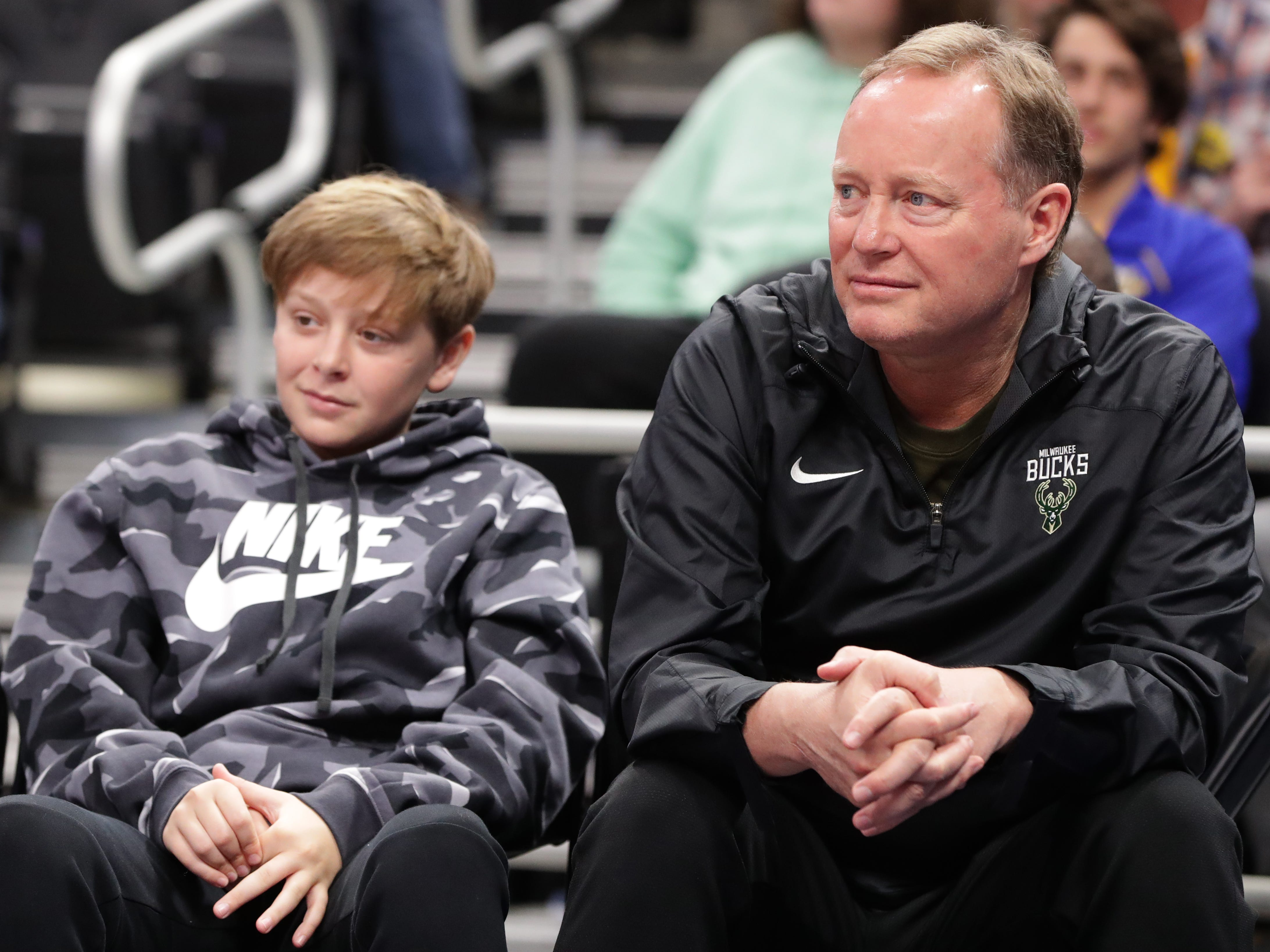 Milwaukee Bucks head coach Mike Budenholzer watches Marquette's  game against Georgetown.