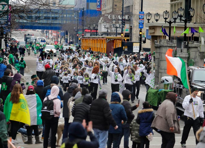 The Glencastle Irish Dancers dance to Irish music and engage the crowd during the St. Patrick's Day Parade in Milwaukee  March 9, 2019.