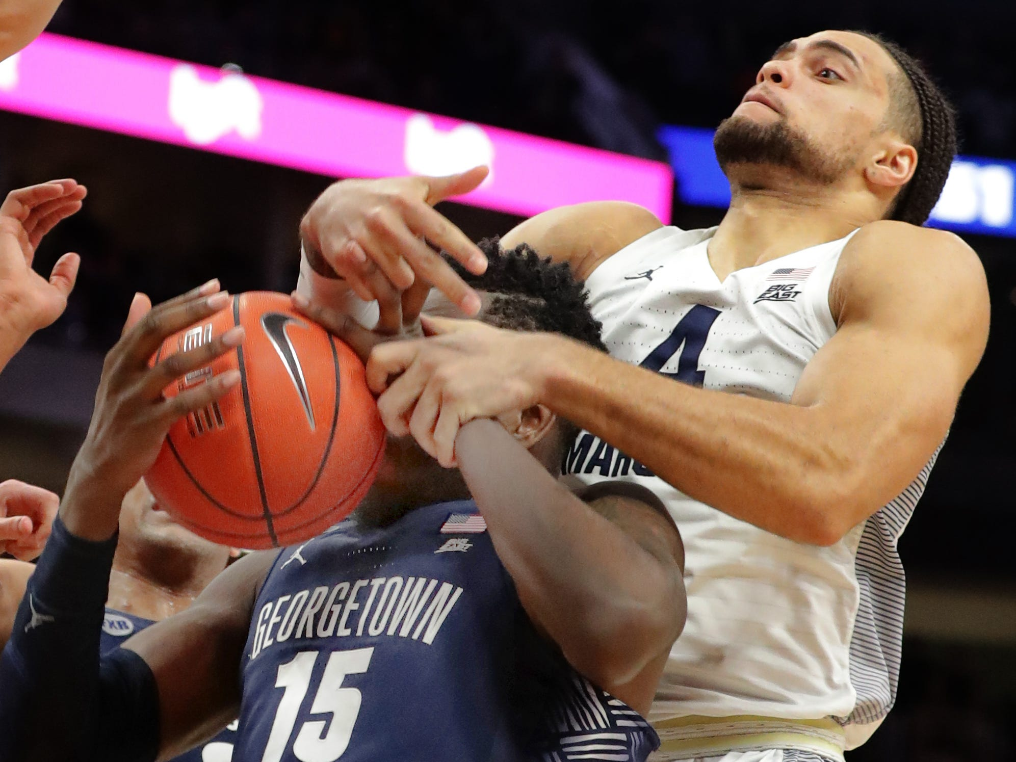 Georgetown center Jessie Govan pulls a rebound away from Theo John in the final minute of the game.
