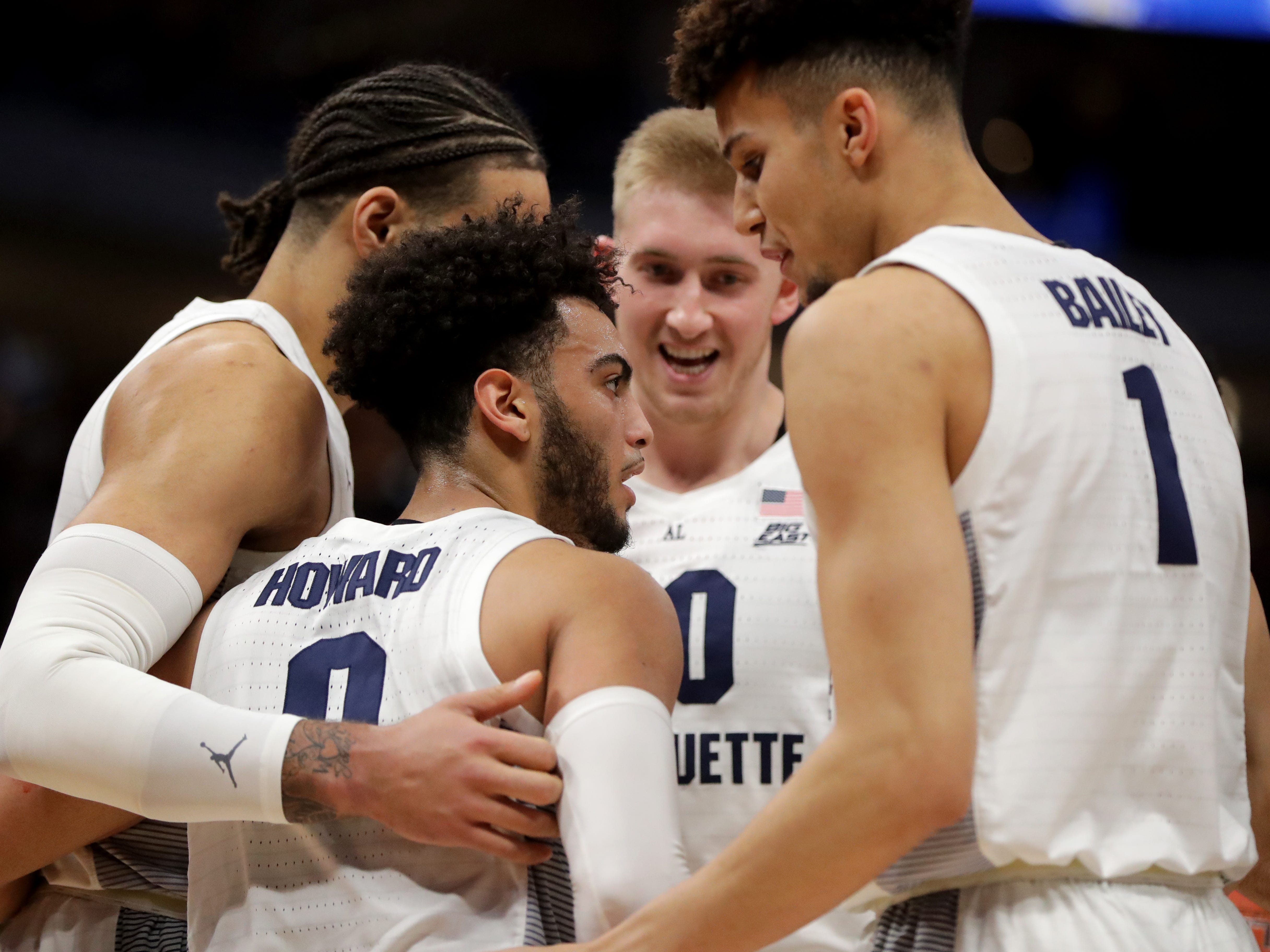 Marquette guard Markus Howard gathers his teammates after being fouled.