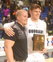 Izard County coach Kyle McCandlis and junior Justus Cooper, who was named the tournament MVP with 16 points, 15 rebounds and four blocks in the final.
