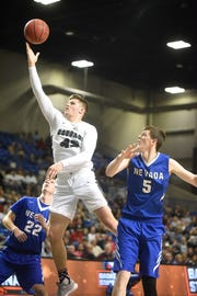 Izard County's Justus Cooper goes up for two against Nevada on Friday night.