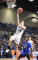 Izard County's Coby Everett goes up for two against Nevada on Friday night.