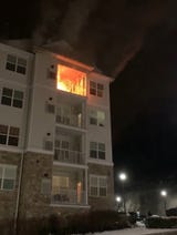 Fire is seen on the balcony of a fourth-floor unit at the Grande at Riverdale condo complex in Riverdale. Video courtesy Sean Mirror. March 8, 2019