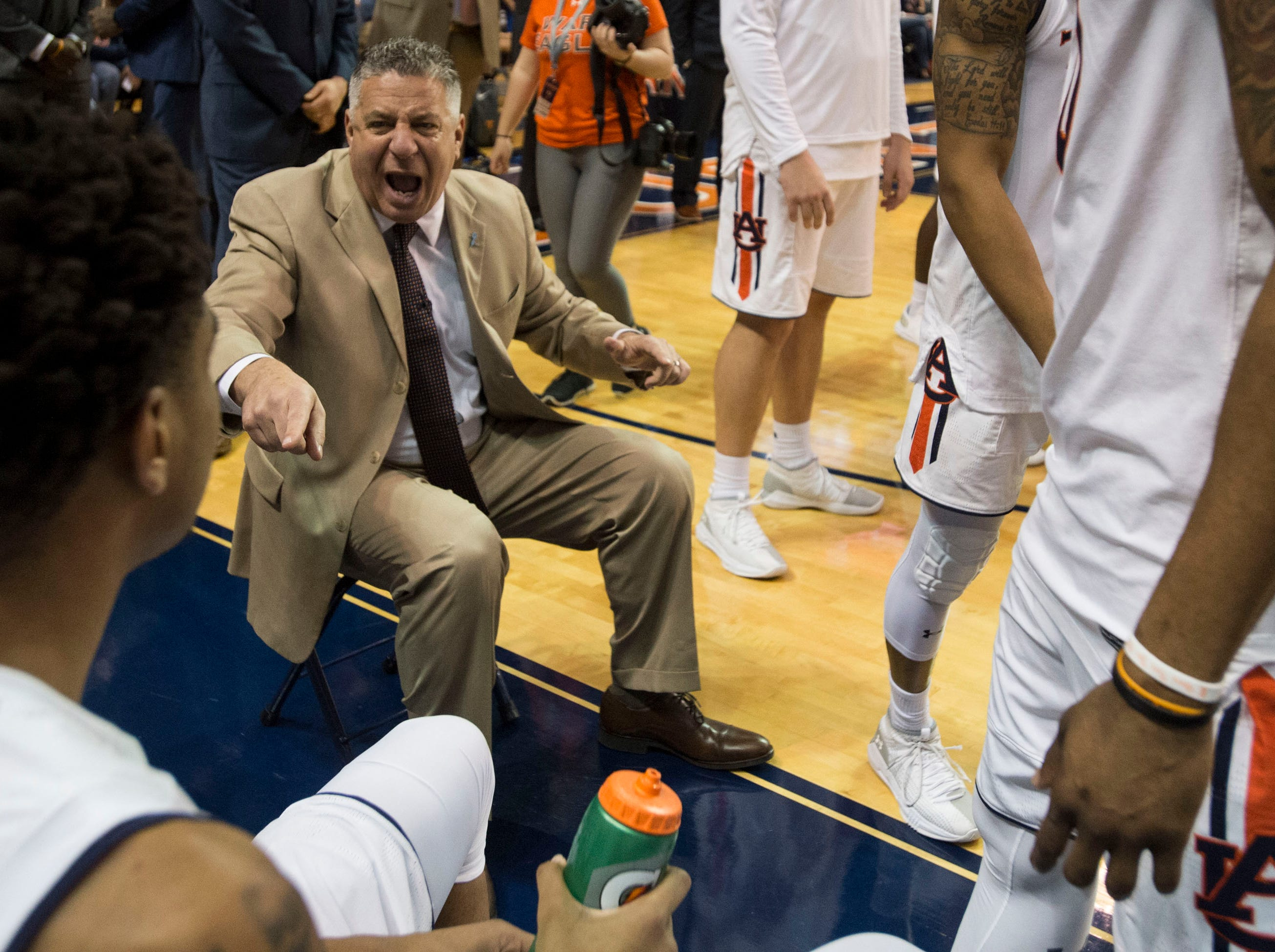 Auburn head coach Bruce Pearl pumps up his team before the game at Auburn Arena in Auburn, Ala., on Saturday, March 9, 2019. Auburn defeated Tennessee 84-80.