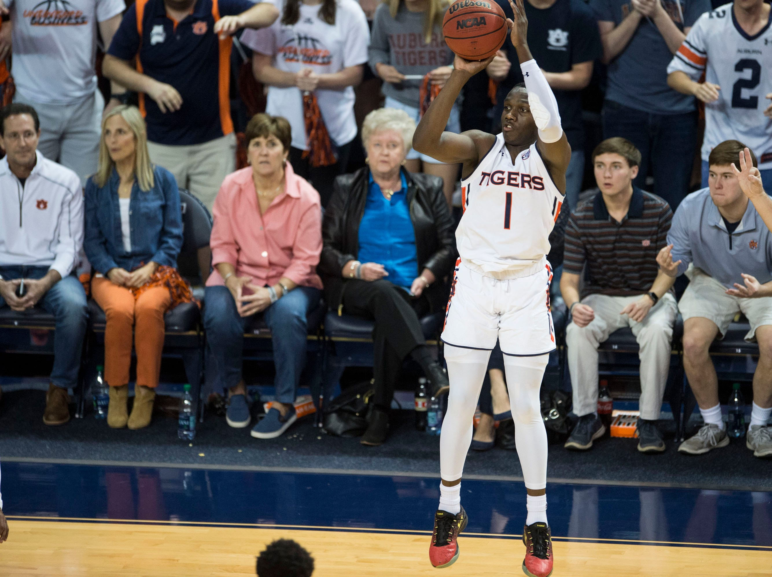 Auburn guard Jared Harper (1) takes a three pointer at Auburn Arena in Auburn, Ala., on Saturday, March 9, 2019. Auburn defeated Tennessee 84-80.