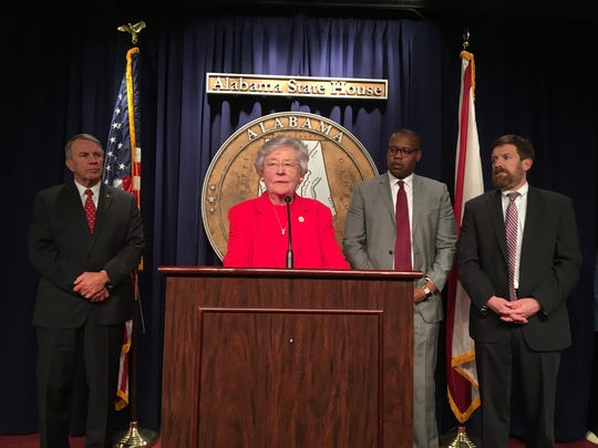 Gov. Kay Ivey speaks to reporters after the House of Representatives approved a 10-cent-a gallon tax increase for infrastructure on March 8, 2019. Behind Ivey (left to right): House Speaker Mac McCutcheon, R-Monrovia; House Minority Leader Anthony Daniels, D-Huntsville, and Rep. Bill Poole, R-Tuscaloosa.