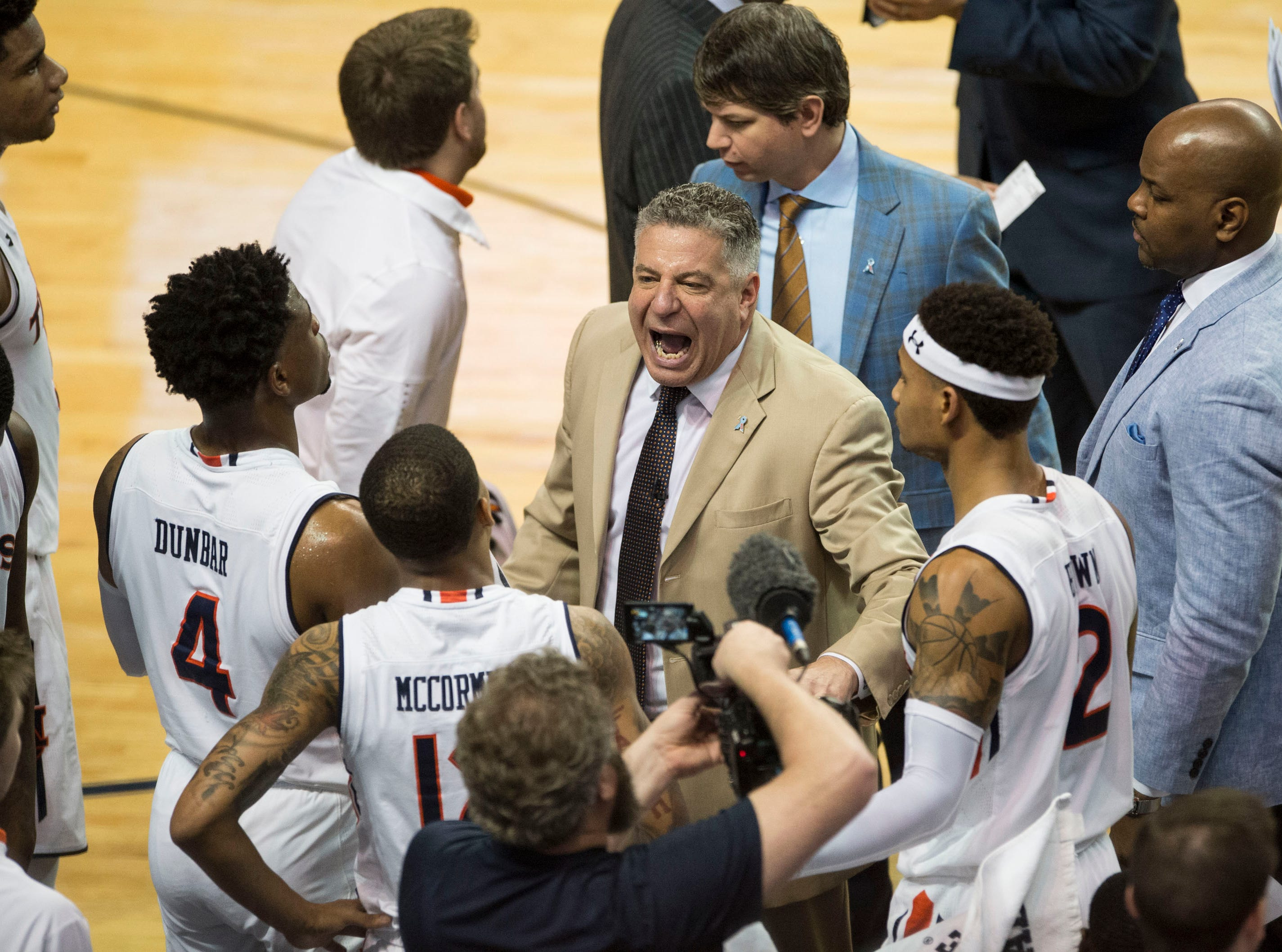 Auburn head coach Bruce Pearl talks with his team during a timeout at Auburn Arena in Auburn, Ala., on Saturday, March 9, 2019. Auburn defeated Tennessee 84-80.