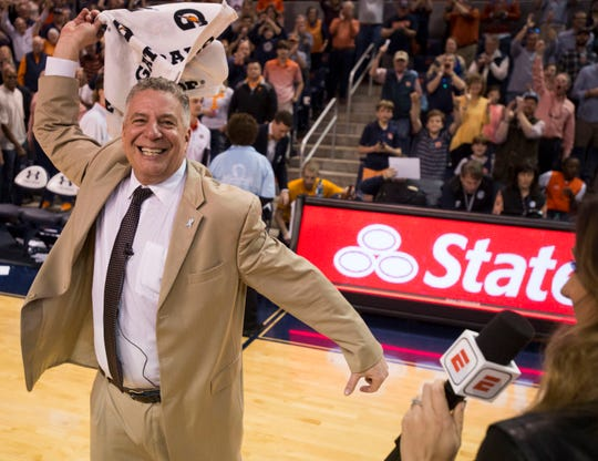 Auburn head coach Bruce Pearl celebrates after the game at Auburn Arena in Auburn, Ala., on Saturday, March 9, 2019. Auburn defeated Tennessee 84-80.