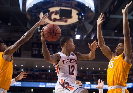 Auburn guard J'Von McCormick (12) looks to make a pass at Auburn Arena in Auburn, Ala., on Saturday, March 9, 2019. Auburn defeated Tennessee 84-80.