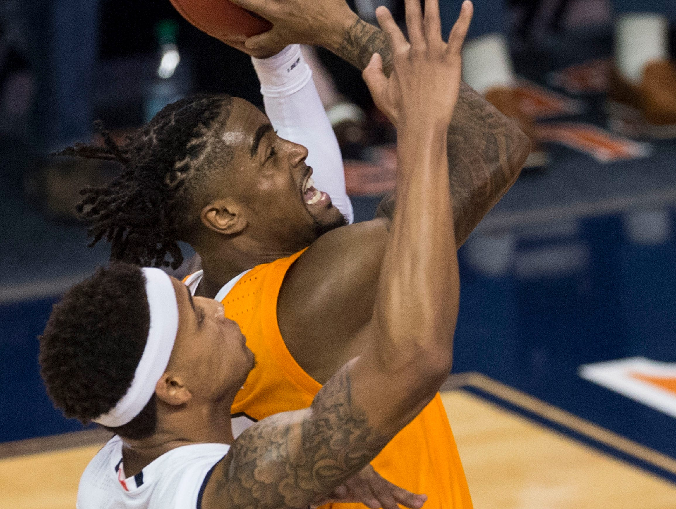 Tennessee guard Jordan Bone (0) goes up for a layup over Auburn guard Bryce Brown (2) at Auburn Arena in Auburn, Ala., on Saturday, March 9, 2019. Auburn defeated Tennessee 84-80.