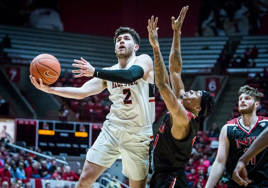Ball State's Tayler Persons shoots past Northern Illinois' defense during their game at Worthen Arena Friday, March 8, 2019.