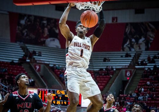 Ball State's KJ Walton dunks against Northern Illinois' defense during their game at Worthen Arena Friday, March 8, 2019.