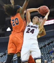 Belmont's Jenny Roy tries to get a shot off against UT-Martin's Chelsey Perry in the OVC tournament championship Saturday at the Ford Center in Evansville, Ind. Roy was the tournament's MVP.