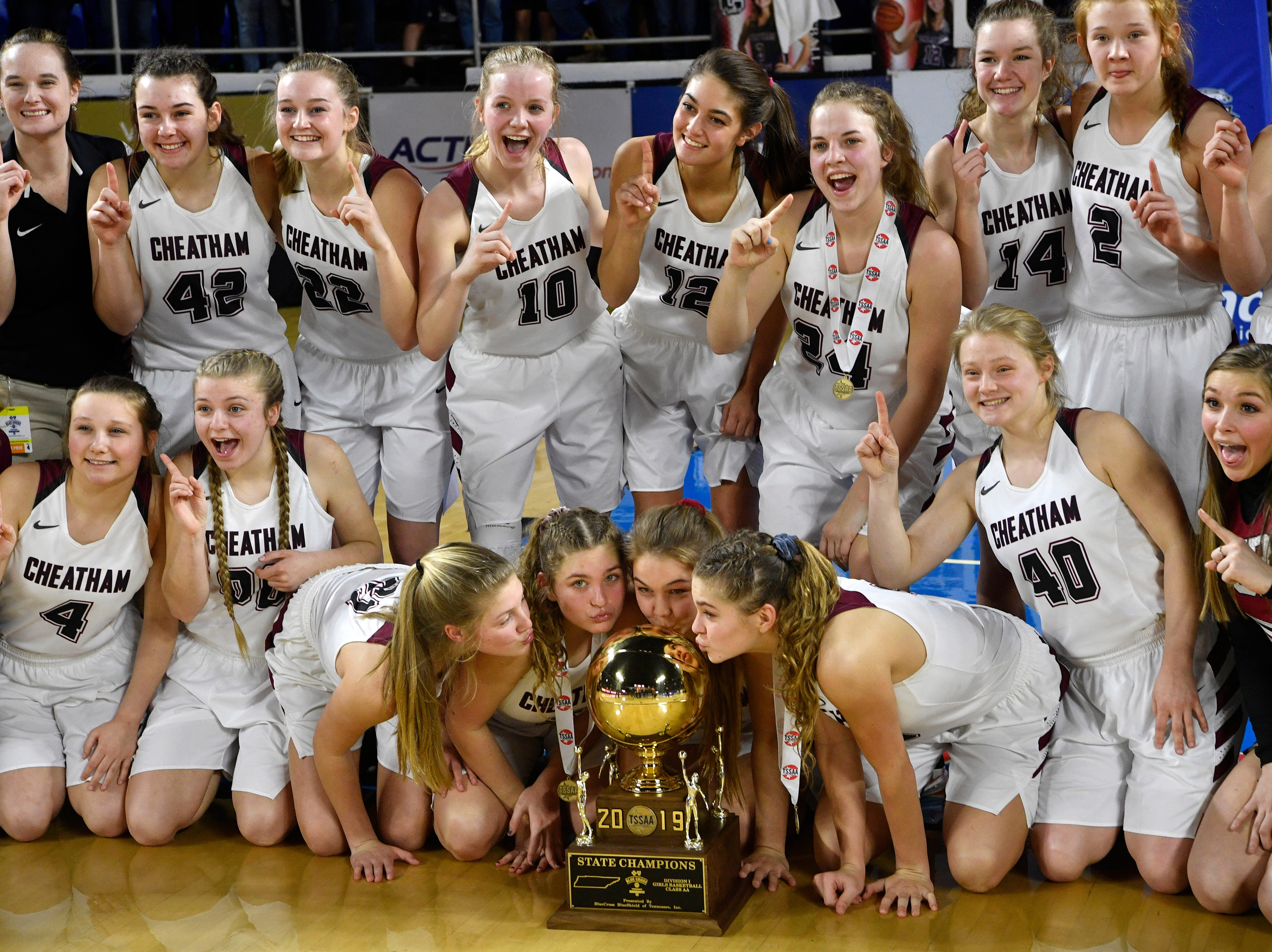 Cheatham County player kiss the trophy after they defeated  Westview in the Class AA Championship Saturday, March 9, 2019, in Murfreesboro, Tenn.