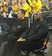 Magic Johnson watches the OVC Tournament at the Ford Center in Evansville, Ind.