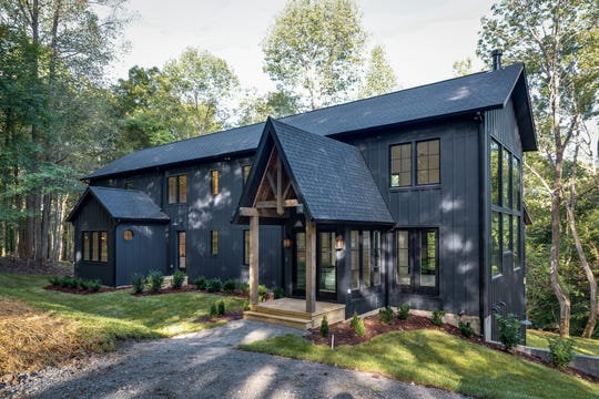 Some Williamson County residents went to Carbine and Associates for a custom-built farmhouse and opted to paint the exterior black instead of the more traditional white.