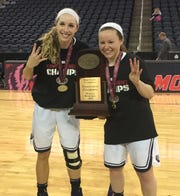 Belmont's Jenny Roy, the OVC tournament MVP, and Darby Maggard, the player of the year, show off the Bruins' OVC tournament trophy.