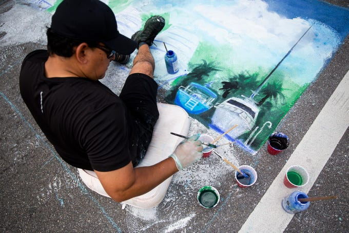 Mauricio Garay works on his chalk artwork during the Naples Chalk Art festival on Fifth Avenue South on Saturday, March 9, 2019. This was Garay's first year participating in the annual event.