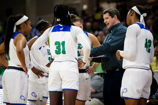 FGCU head coach Karl Smesko talks to his players during a timeout in a quarterfinal game of the Atlantic Sun Conference WomenÕs Basketball Tournament against New Jersey Institute of Technology at Alico Arena at FGCU in Fort Myers on Friday, March 8, 2019.