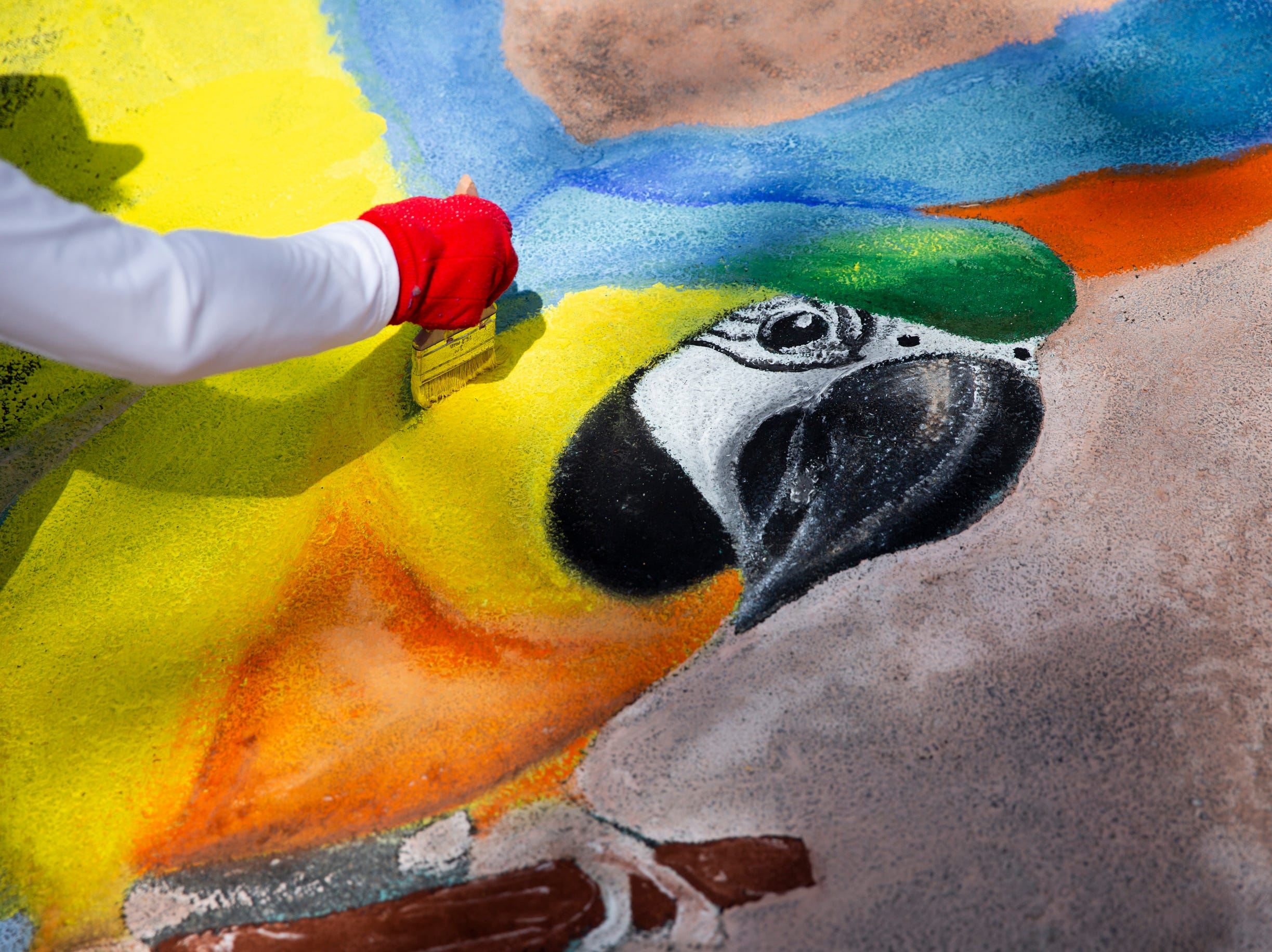 Joni Long works on her chalk artwork during the Naples Chalk Art festival on Fifth Avenue South on Saturday, March 9, 2019.