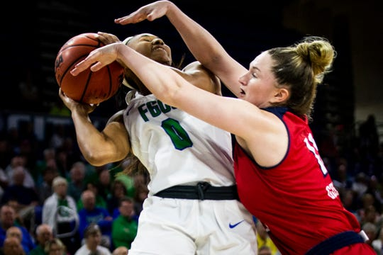 FGCU's Davion Wingate is blocked by Kelly Guarino during a quarterfinal game of the Atlantic Sun Conference WomenÕs Basketball Tournament against New Jersey Institute of Technology at Alico Arena at FGCU in Fort Myers on Friday, March 8, 2019.