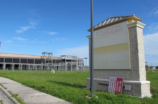 Work is being done to prepare for completion this year of the large steel-frame building that has loomed for a decade on the southwest corner of Davis and Collier boulevards in East Naples.