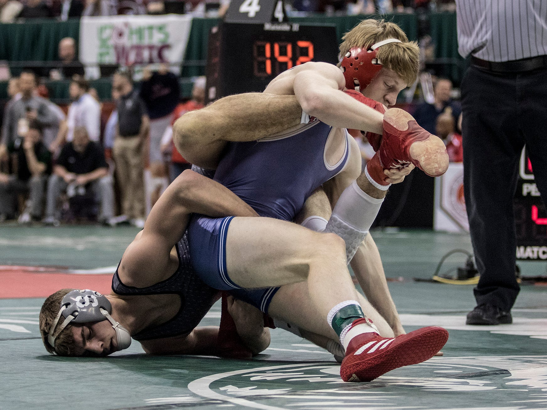 Jordan Barnett of Sheridan, wrestles in the Division II 145 weight class at the state wrestling tournament Saturday.