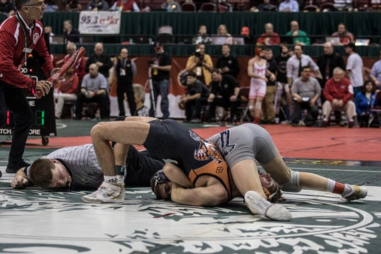 Blake Sheppard, of New Lexington, wrestles in the 113-pound seventh-place match of the Division II state meet. Sheppard lost that match but still placed eighth to earn All-Ohio honors.