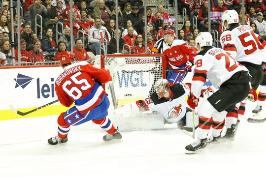 Washington Capitals left wing Andre Burakovsky (65) scores a goal on New Jersey Devils goaltender Mackenzie Blackwood (29) in the first period at Capital One Arena.