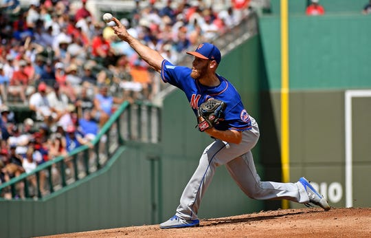 Mar 9, 2019; Fort Myers, FL, USA; New York Mets starting pitcher Zack Wheeler (45) delivers a pitch in the first inning against the Boston Red Sox the spring training game at JetBlue Park.